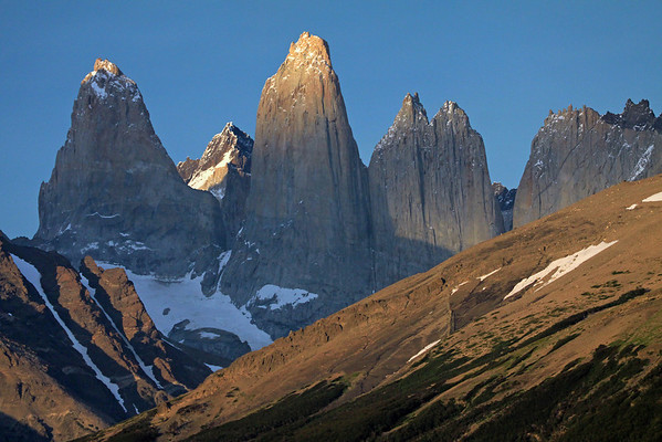 Beyond the forest of Lenga Beech, along the slope of Cerro Paine - to the shaded glacial streams, along the sunlit and shadowed slope of Mt. Almirante Nieto - to the slightly sunlit peak of Torre Sur, with the Cerro Fortaleza beyond, and the glacier below - with Cerro Central, displaying its sunlit peak and now cloud-shadowed lower face - the twin peaks of Torre Norte, with the direct sunlight just starting to illuminate its peaks, and a cloud shadowing its mid-upper face - Cerro Nido Condor (r), and beyond to a slight view of Cerro Escucio (slightly illuminated).