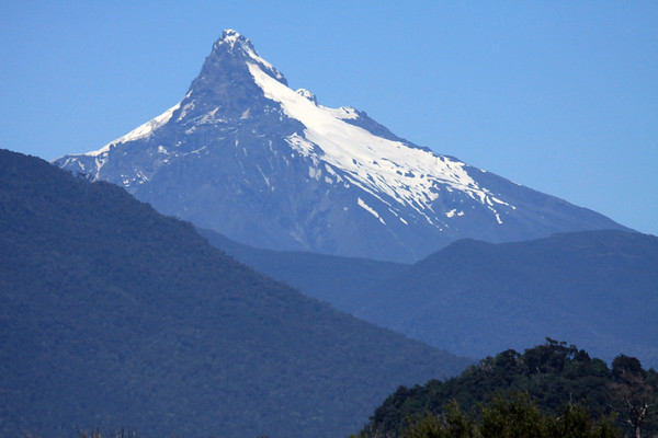Volcan Corcovado - a stratovolcano, composed of igneous volcanic basalt, rising to about 7,546 ft. (2,300 m).