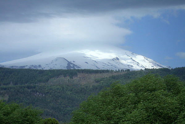 Villarrica Volcano - northeastern view of the active stratovolcano, capped with glacial ice, and rising to about 9,340 ft. (2,847 m), near 39°30' S and 72° W - which forms the region borders of Araucania (n), the Cautin (province) - with the Los Rios region (s), the Valdavia (province) - in the western area of Villarrica National Park.
