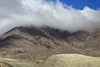 Up the southern slope of Morro Moreno, thru the cumulus clouds, to the azul sky above the Atacama Desert.