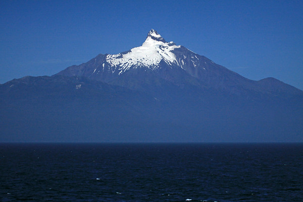Western view of Volcan Corcovado, rising about 7,546 ft. (2,300 m), from here above the Gulf of Corcovado, the Pacific Ocean.