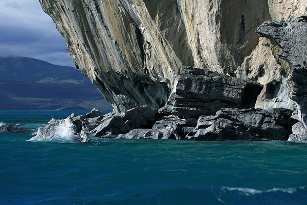 From the waves breaking upon the eastern end, of the marble peninsula (south of PuertoTranquilo, town) - composed of water eroded and sculpted metamorphic calcite marble - part of Capillas de Marmol Nature Santuary - Aisen region, about 46° 40' S and 72° 40' W - this is the Patagonia Andes, the very northern extent of the Patagonia Volcanic Gap, just south of the Southern Volcanic Zone - the transition area between the Patagonia Steppe (shrubs and grass) and Magellanic Subpolar Forest (temperate broad leaf and mixed forest, predominately the southern beech trees) ecoregions - the Austral Zone (natural region), characterized by glaciation and ice fields - southern Chile.