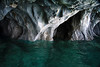 Water sculpted marble sea cave rock - fuses with the submersed marble rock, from the glacial milk water of Lago Carrera.