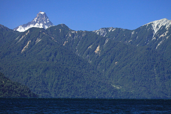 Lake All Saints - southern beech tree forested slopes - peak of Volcan Puntiagudo.