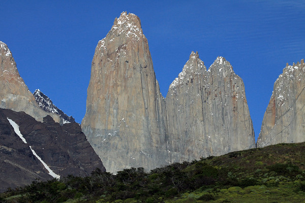 From the vegetated lower southern slope of Cerro Paine - to the northern slope of Mt. Almirante Nieto, displaying a glacial ice stream - beyond to Torres Sur, and beyond its northern buttress to the summit of Cerro Fortaleza - with Torre Central, adjacent to the twin peaks of Torre Norte (c) - and the upper jagged ridge of Cerro Nido Condor (r).