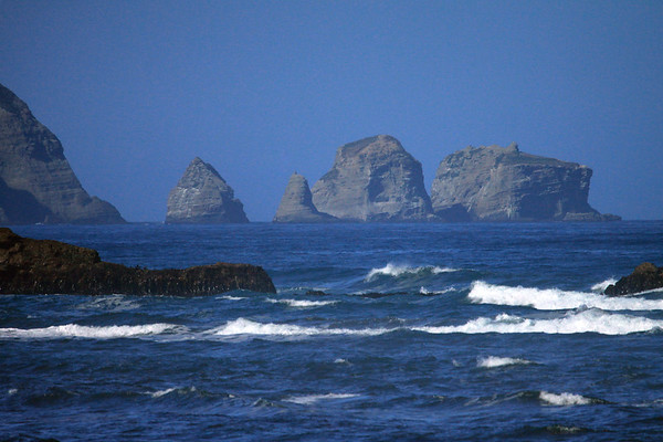 Sea stacks, off the western end of Punta Pirulil - from beyond the waves and outcrops of Bahia Cucao.