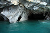 Marble sea caves fuse with the glacial milk water, along the western shoreline, of Lago Carrera.