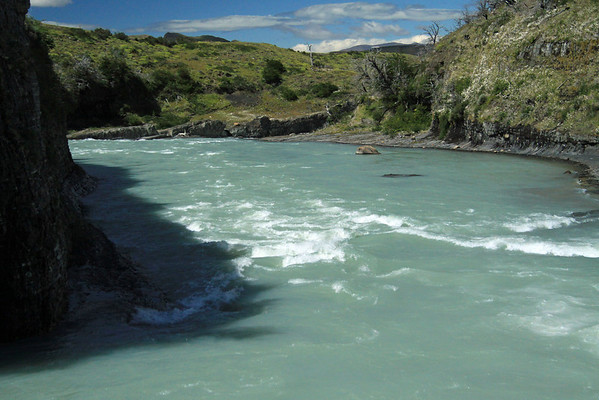 Glacial water rapids below the Paine Waterfall.