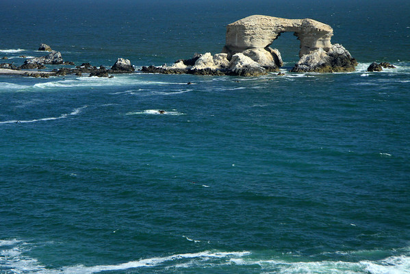 "La Portada (the Gateway) Natural Monument (1990) - located in the Bahia Moreno - Antofagasta region - northern Chile - here during the beginning of ""flood tide"" (the period between high tide and the next low tide in which the sea is rising)."