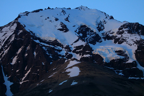 Day's first rays - actually the year's first rays - this 1/1/13 morning of near the apparent sunrise of 5:37 - here at about 51° S and 73° W - viewing at the hanging glaciers along the slope, up to the summit of Mt. Almirante Nieto.