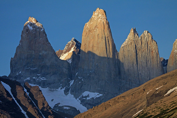 Beyond Cerro Paine (r) and Mt. Almirante Nieto - to the early morning sunlit Torres del Paine - with Torre Fortaleza, distal between Torre Sur and Torre Central - and a slight glimpse of the partially sunlit Cerro Escucio, between the twin peaks of Torre Norte and upper slope of Cerro Nido Condor.