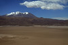 Across the Salar Carcote - to Volcan Aucanquilcha, below the cumulus clouds - northern Antofagasta region.