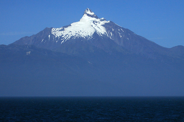 Volcan Corcovado - displaying its glacial ice and extrusive volcanic basalt rock peak - Los Lagos region - southern Chile.