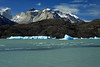 Across Lago Grey - to the blocky iceberg and bergy bits - with Cuernos del  Paine (c), adjacent to La Espada (sword) and La Hoja (blade) - Mt. Almirante Nieto (distal, r) - Cerro Fortaleza (distal, l).