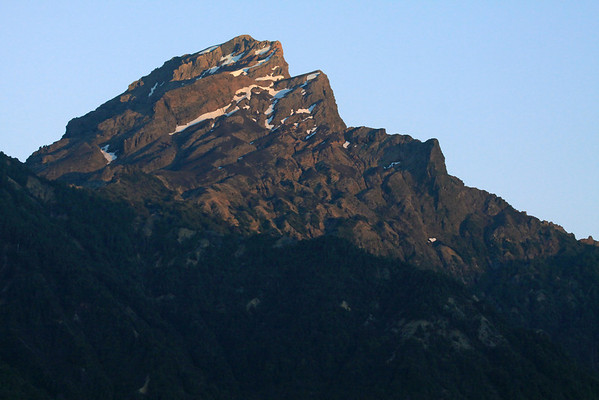 Early morning light upon the igneous rock and glacial ice peak of Cerro Picada, rising to around 5,610 ft. (1,710 m).