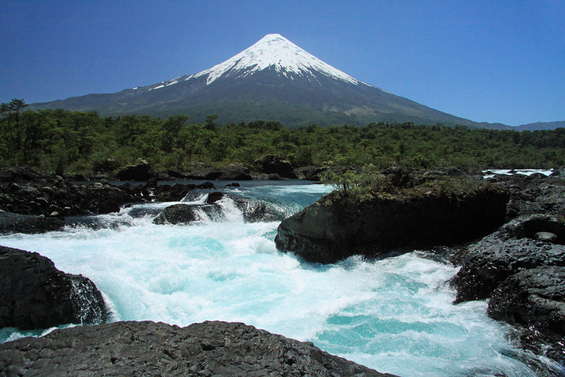 Up the glacial milk or rock flour water of Rio Petrohue - to the conical glacial cap atop, the Osorno Volcano, an active stratovolcano, at about 41° S, 72° 30′ W - part of the Northern Patagonia Batholith (which extends from about 39°- 47°S), along the Patagonia Andes - and the Southern Volcanic Zone (which extends 33°- 46° S) - the Zona Sur (southern zone) of southern Chile, characterized by valdivian vegetation, glacial lakes, low elevated Patagonia Andes (with intensive volcanic and geothermal activity).