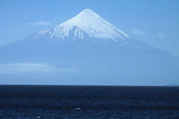 Across Lago Llanquihue - to a cumulus cloud, along the base of the glacial ice cap, of Volcan Osorno (whose substratum is comprised of granodiorite, an intrusive granite).