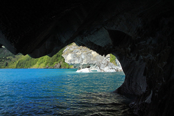 From a sea cave along the Catedral de Marmol (Marble Cathedral) - beyond the metamorphic marble outcrops, to the Capilla de Marmol (Marble Chapel) - and distal western shoreline of Lago Carrera.