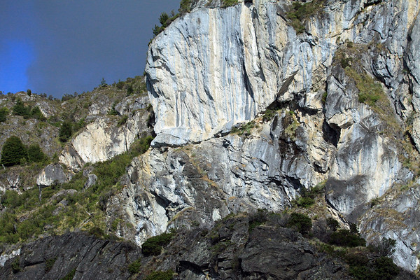 Metamorphic marble cliffs, scattered with Patagonia vegetation - along the western slope of Lago Carrera.