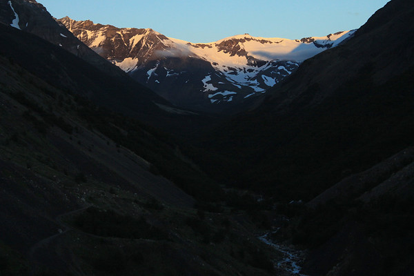 Up the Valle Asencio, to its confluence with the Valle Silencio - below the sunlit slope of Cerro Oggioni (l).