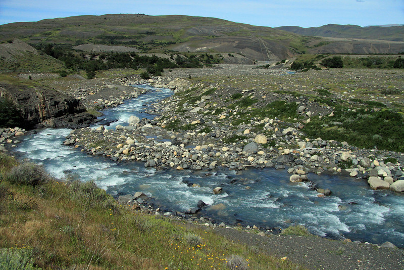 Rio Asencio - meandering its early summer season glacial water, along the rocky banks, and among the grassland, shrubs, cushion plants, and southern beech tree vegetation - Torres del Paine National Park.