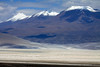 Across the Salar Ascotan, and the endorheic lagoon, in the northern Antofagasta region - and up the partially cloud-shaded slopes, now in Bolivia, to Cerros Cañapa, rising to about 19,298 ft. (5,882 m).
