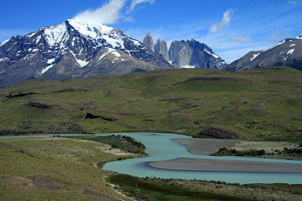 Across the meandering southeastern area of Rio Paine, displaying its glacial milk/flour (green hue) water - across the Patagonia Steppe ecoregion terrain - to Mt. Almirante Nieto (l) - beyond to Torres Central and Norte, adjacent to Cerro Nido Condor.