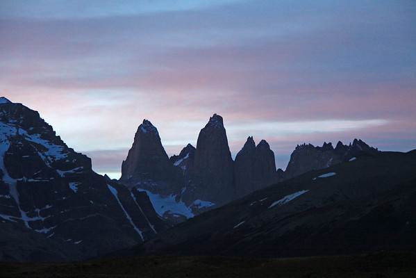Sunset glow upon the Torres del Paine - from beyond the slopes of Cerro Paine (r) and Almirante Nieto (l) - with Cerro Fortaleza distal between Torre Sur and Torre Central - and Cerro Escucio, distal between Cerro Norte and Cerro Nido Condor.