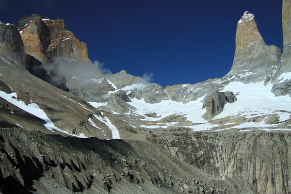 Clouds forming among the western slopes and ridges of Mt. Almirante Nieto (l) - Torres Sur and Central (r) - with La Hoya (c), the blade.
