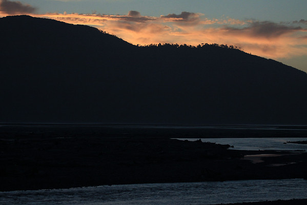 Across the Rio Yelcho - to the silhouette of Isla Puduguapi - to the sunset glow upon the clouds.