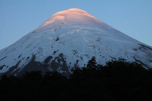 Day's first rays upon the glacial ice peak, of Volcan Osorno.