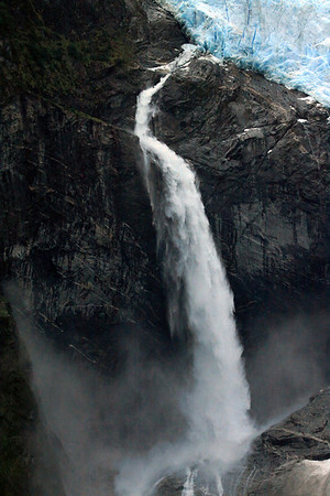 Ventisquero Colgante - with one of its plunge falls, descending onto the igneous rock below, and forming a mist cloud - Queulat National Park - Aisen region.