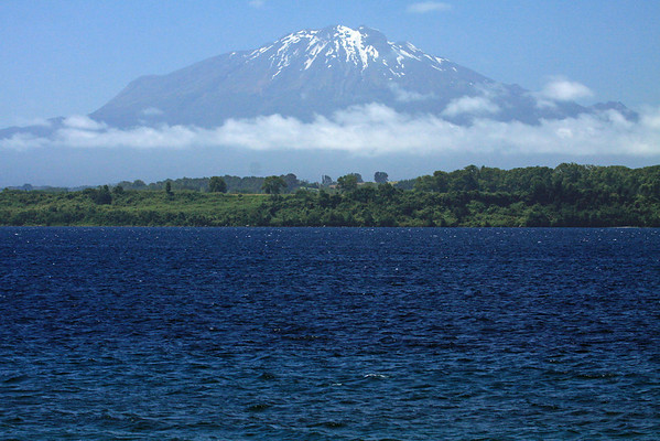 Volcan Calbuco, an active stratovolcano, an andesite volcano (composed of extrusive igneous volcanic rock) - from across the white-caps upon Lago Llanquihue - this is an area of the Patagonia Andes, where tectonic, glacial, and volcanic processes have sculpted the terrain of the Los Lagos region.