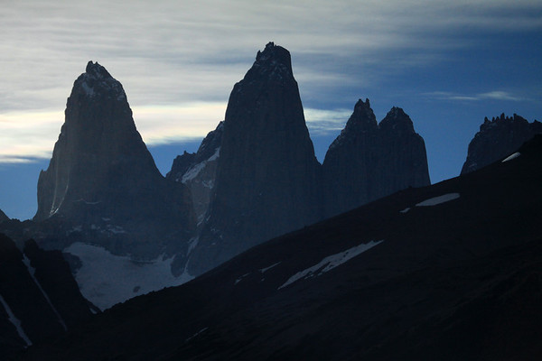 Late evening upon the spires of the Towers of Paine - with Cerro Fortaleza, distal between Torres Sur and Central - and Cerro Nido Condor (r), adjacent to the twin peaks of Torre Norte - with the foreground slopes of Cerro Paine (r) and Mt. Almirante Nieto (l).