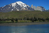 Rio Paine - to Mt. Almirante Nieto - then to the peak only of Torre Sur, next is Torre Central, adjoined by the col Bich (the lowest point between two peaks) to the twin peaks of Torre Norte - next is the granite top peak and lower hornfels ridge cap, of Cerro Nido Condor - with the lower southern ridge of Cerro Paine (horizon, r).