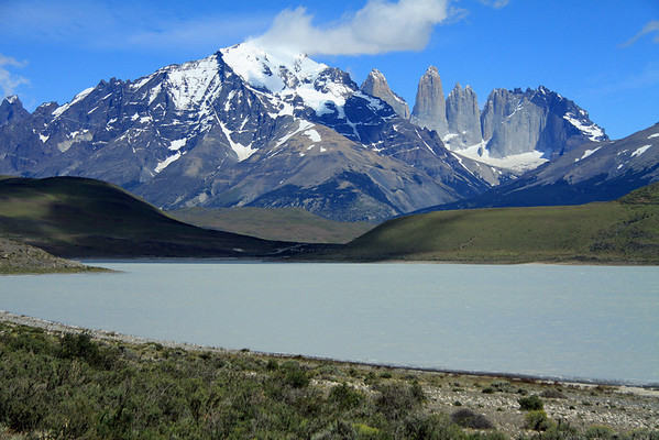 Westward view across Laguna Amarga, an endorheic lagoon - beyond to Mt. Almirante Nieto (c) - Cuerno Principal (l) - and the Paine Towers (r), with the adjacent hornfels-capped Cerro Nido Condor.