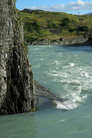 Glacial water rapids, along the sedimentary rock shoreline, of the Paine River.