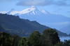 Fjord Reloncavi - to the glacial ice slopes and volcanic rock peak, or Volcan Yate - Los Lagos Region - southern Chile.