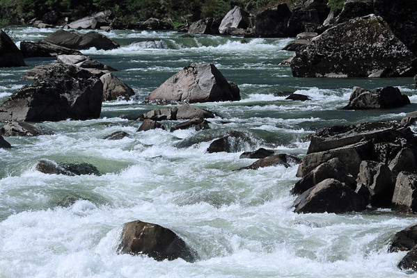 Whitewater among the igneous rock boulders, along the Rio Simpson.