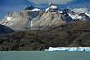 Across the blocky iceberg and peninsula at Lago Grey - to the Horns of Paine (Norte, Principal and Este), displaying their metamorphic hornfels rock caps above the granite base - with La Hoya (blade) and La  Espade (sword),adjacent (l) - and Mt. Almirante Nieto (distal, r).