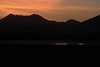 Twilight dawn across the northeastern Salar Ascotan - with the silhouettes of Cerro Tapaquilcha (l) - Cerro Cachi Laguna (r).