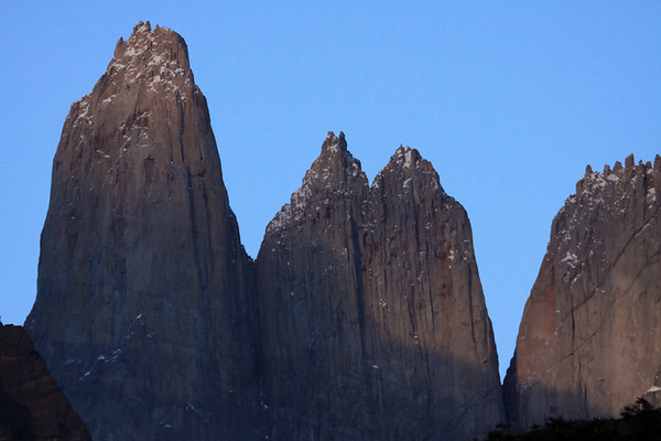 Morning sunlight upon Torre Central (l) - the twin peaks of Torre Notre (c) - and upper jagged ridge of Cerro Nido Condor (r).
