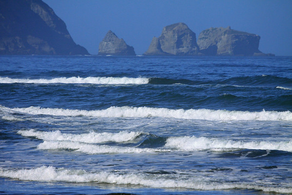 Morning sunlit waves along the shoreline of Bahia Cuacao - to the sea stacks, just off Punta Pirulil - western Isla Chiloé.
