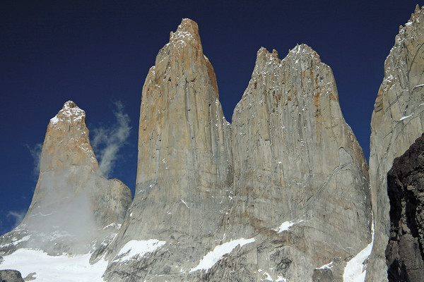 Torres del Paine - Sur (l), among the cumulus clouds, Central, and the Norte (adjacent to Cerro Nido Condor).