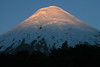 Morning light upon the snow-coated glacial ice slope, of Volcan Osorno.