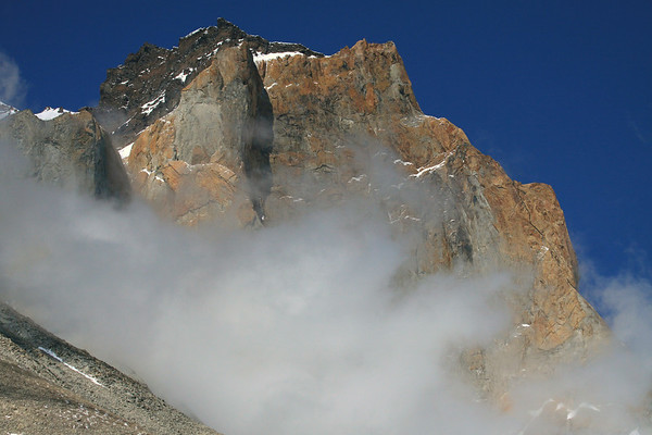 Clouds among the upper western slopes and ridges of Mt. Almirante Nieto - fused with igneous granite and baked metamorphic hornfels atop.