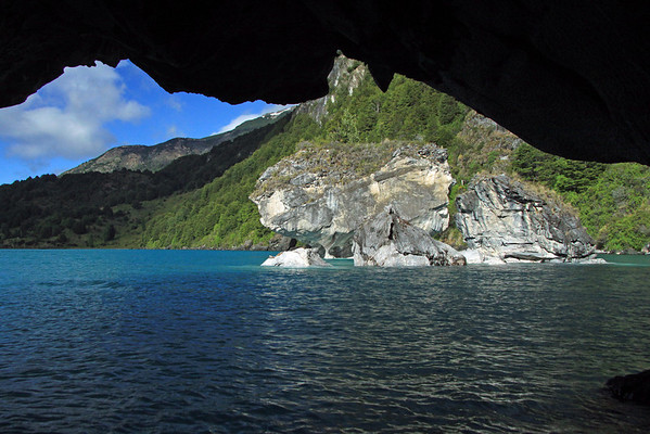From the sea cave of Catedral de Marmol - beyond the 3 marble outcrops - to Capilla de Marmol - and the sunlit and cloud shaded western shoreline of Lago Carrera.