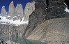 From the lower slope of Cerro Nido Condor, along the shoreline of the glacial milk or rock flour water and glacial till (r) - beyond the glacier melt water streaks upon the base rock, reflecting upon the glacial lake - past the snow-coated glacier - to the 3 granite spires, Towers of Paine.