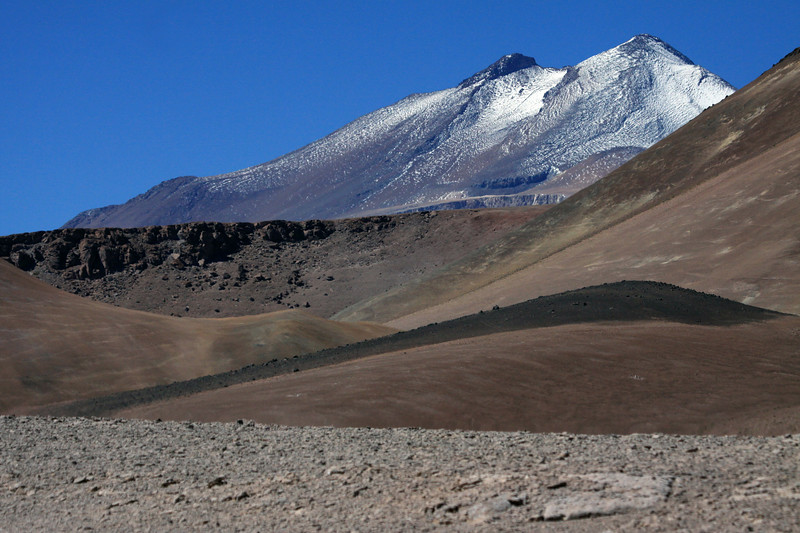 Beyond the slopes and ridges of Cerro Pastillos - to the mid-summer season snow upon the slope and peak of Volcan Copiapo.