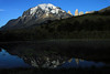Morning reflection of the Torres Del Paine and eastern view of Mt. Almirante Nieto, displaying its glacial ice cap and summit - upon the near ripple-less water of a glacial formed endorheic lagoon - with the minimal ripples created from the 5 Spectacled Ducks, also known as Bronze-winged Ducks - and a pair of Upland or Magellan Goose, with their brood (the male has a white head and breast, the female a reddish-brown). See Chile - Birds (2012-2013) file, starting with about image #73 for images and details.